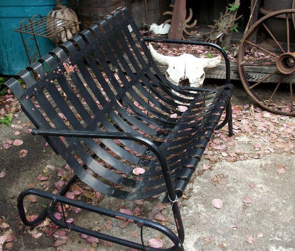 Simple-vintage-outdoor-furniture-with-black-glider-chair-can-be-used-for-two-people