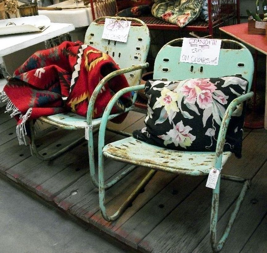 Vintage-outdoor-furniture-with-rusty-old-metal-chairs-and-sofa-cushions-added-for-you-comfort