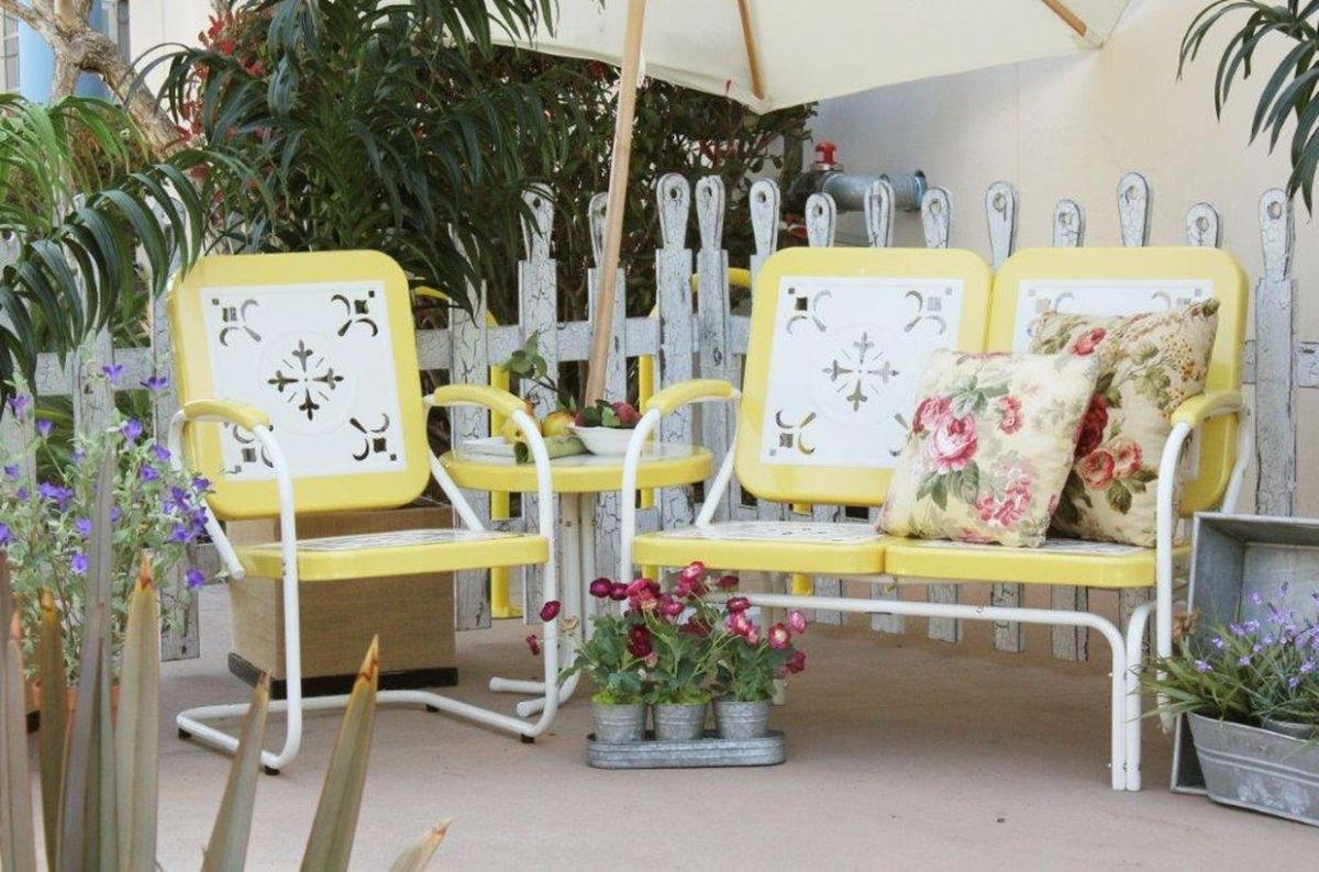 Vintage-outdoor-furniture-with-white-and-yellow-iron-chair-for-relaxing-in-backyard