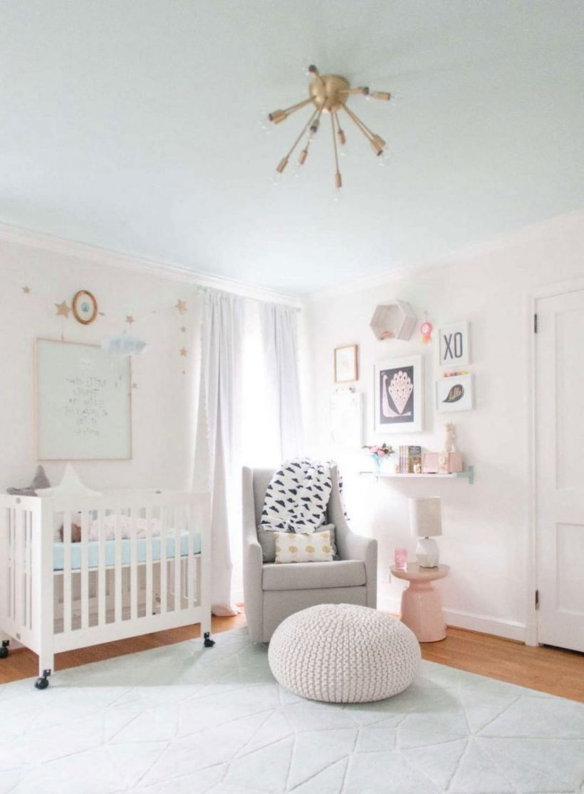 White-cute-baby-girl-room-ideas-with-wooden-white-bed-the-bottom-has-wheels-so-easy-to-move