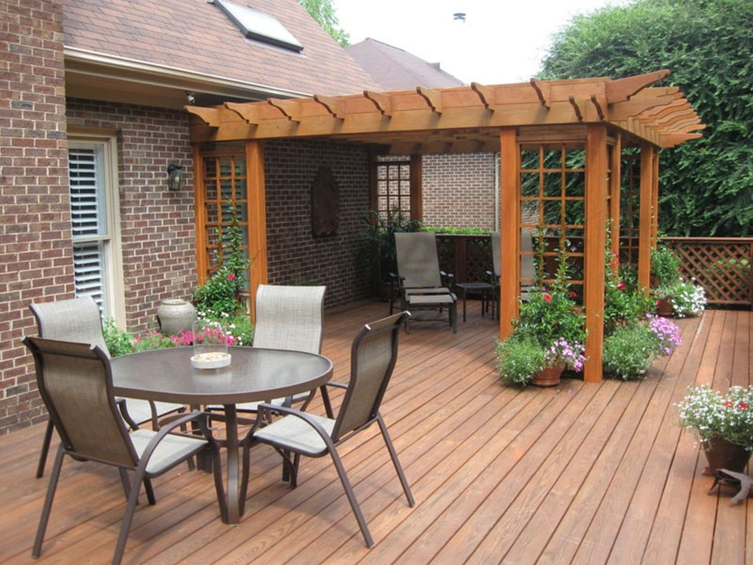 Backyard-patio-deck-design-with-greenery-to-decorate-your-patio-to-get-a-cool-atmosphere