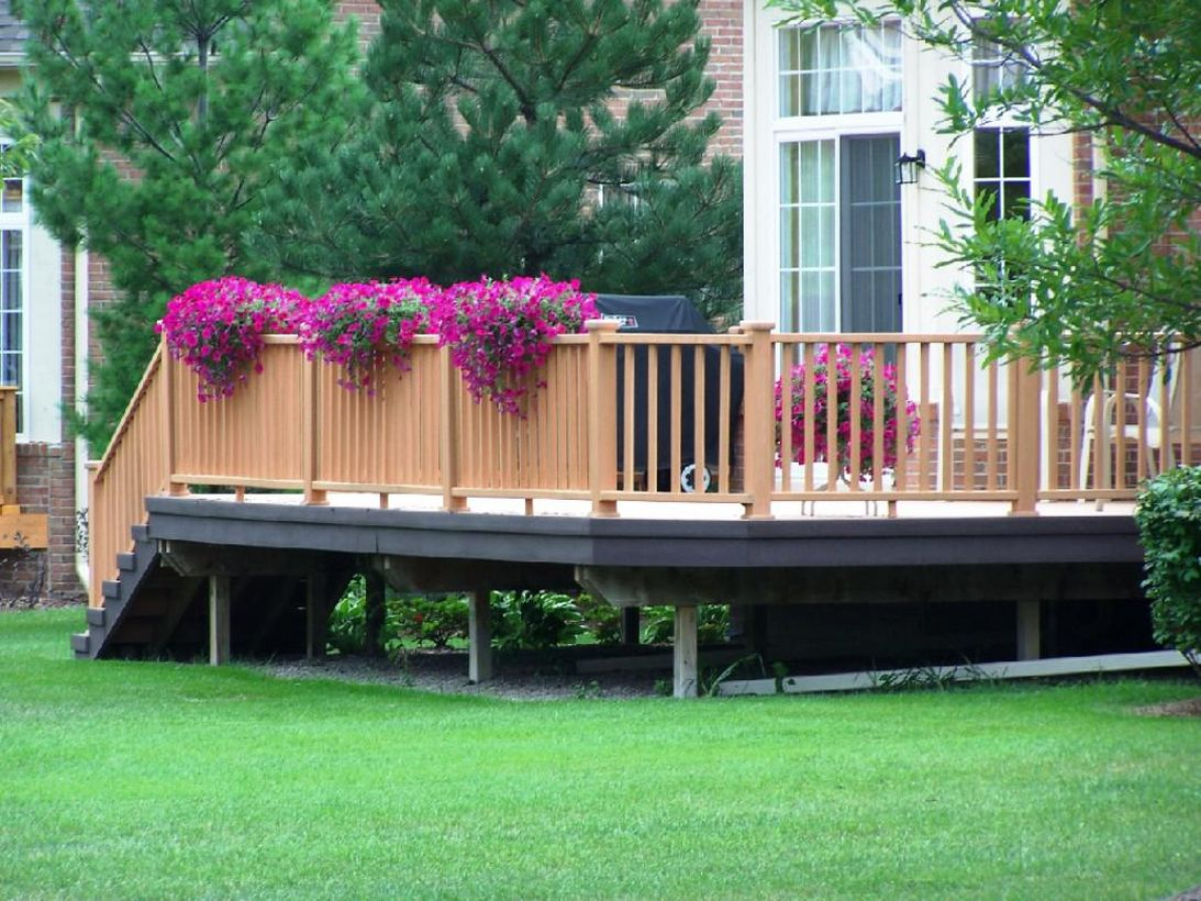 Backyard-patio-deck-design-with-purple-flowers-that-spread-on-your-patio-deck-beeper-adds-a-good-impression