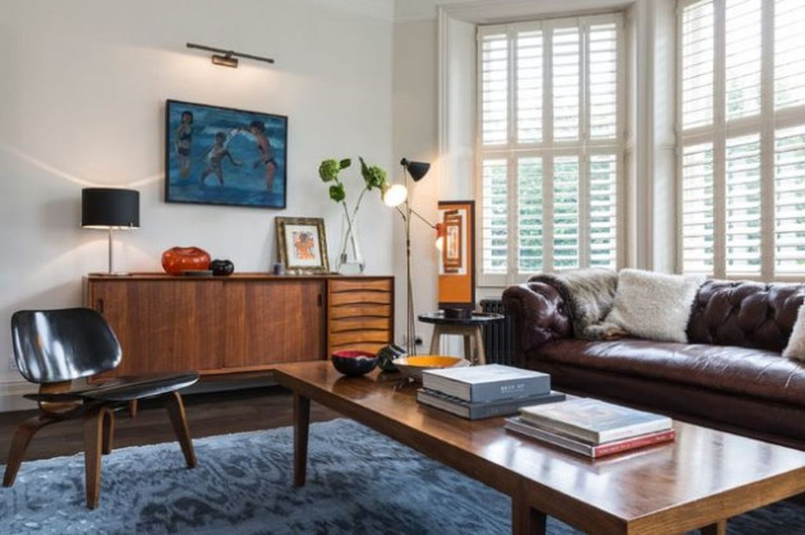Decorating-a-retro-living-room-with-a-long-wooden-thick-coffee-table-and-a-unique-chair-that-is-comfortable-to-relax-in-the-living-room