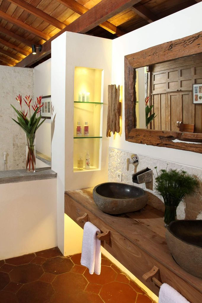 Farmhouse bathroom with wooden frame mirror