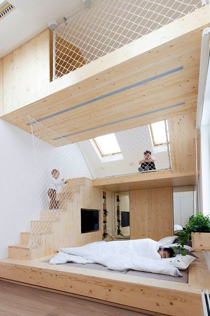 Loft bedroom with wooden walls