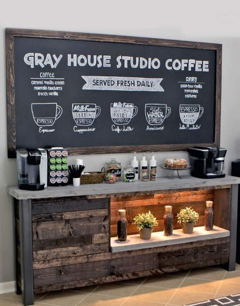 Old wood coffee bar combined with blackboard and potted plants for decoration