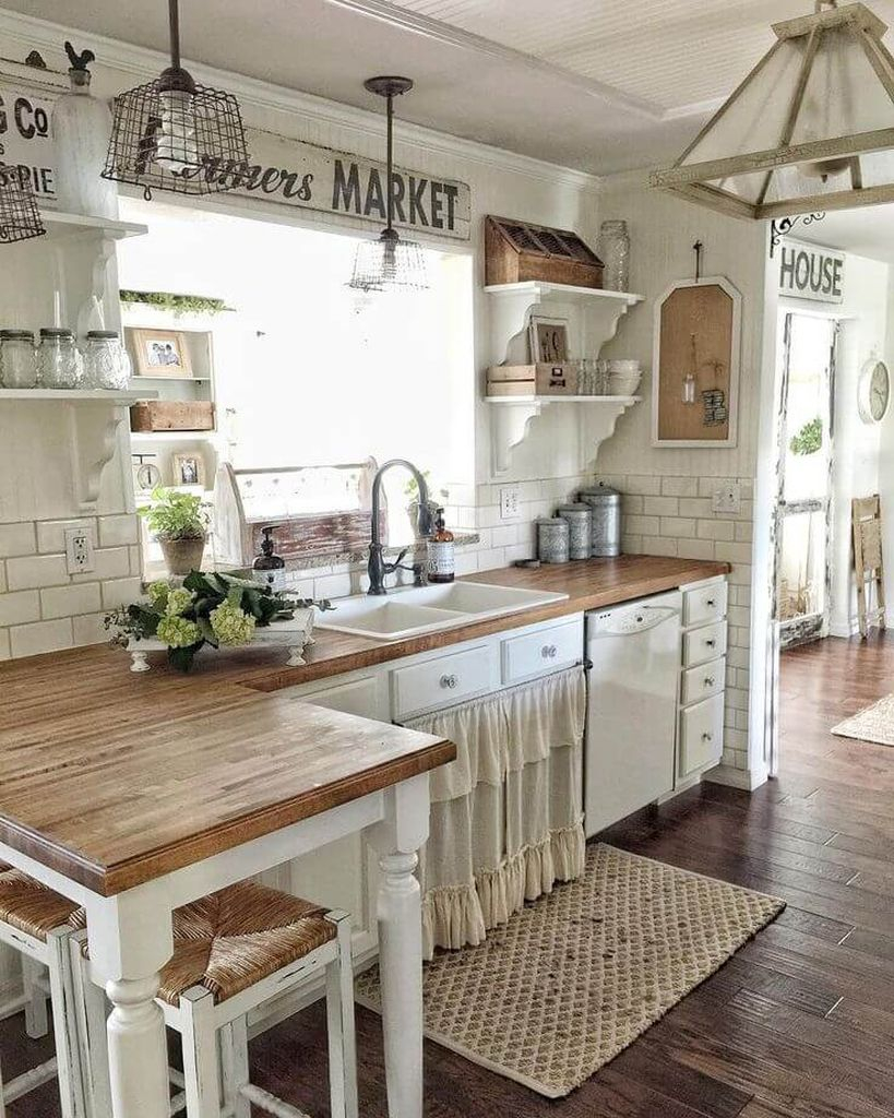 Open kitchen concept with white walls and wooden floor