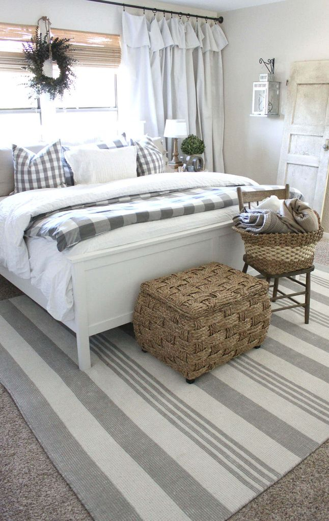 Striped rug combined with white bed and rattan basket