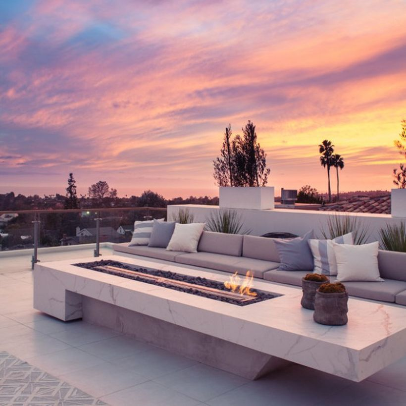 The-fire-pit-inspiration-that-became-the-medium-for-long-granite-tables-and-long-sofas-to-gather-with-the-family-created-a-warm-atmosphere