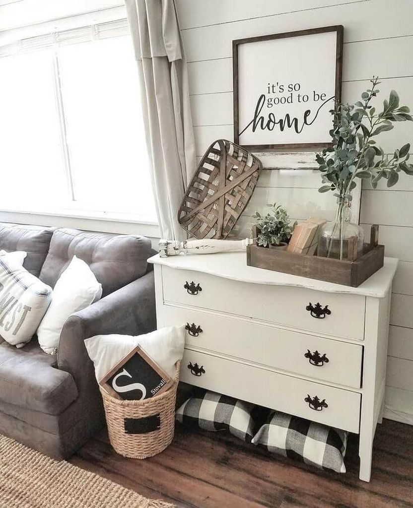 White wooden walls combined with drak grey sofa