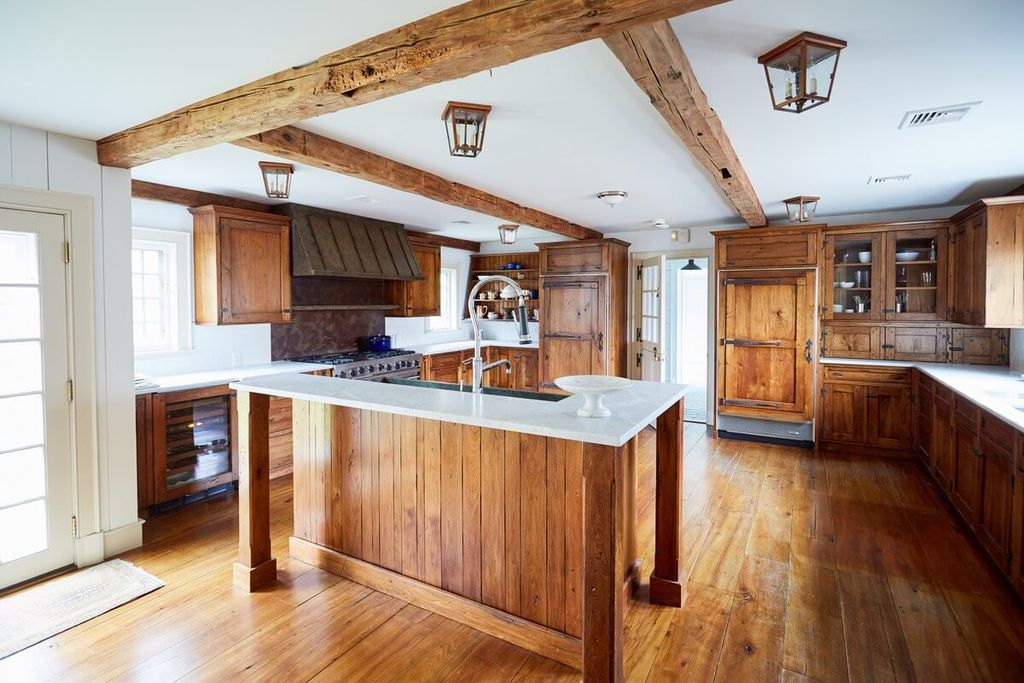 Wooden floor combined with wooden cabinets for farmhouse kitchen