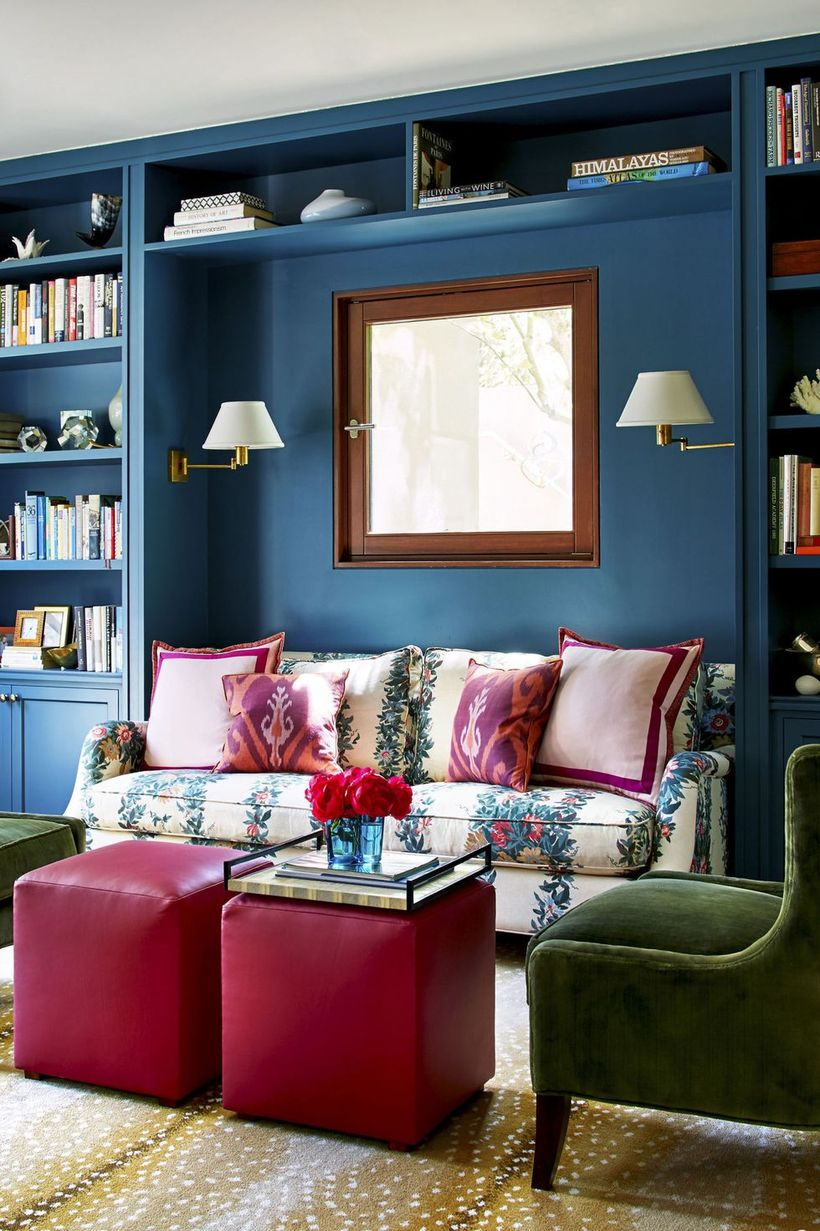 Clever-storage-bookcase-in-the-living-room-with-flower-pattern-sofa-and-red-coffee-table-from-leather-to-create-you-comfortable-being-in-this-room