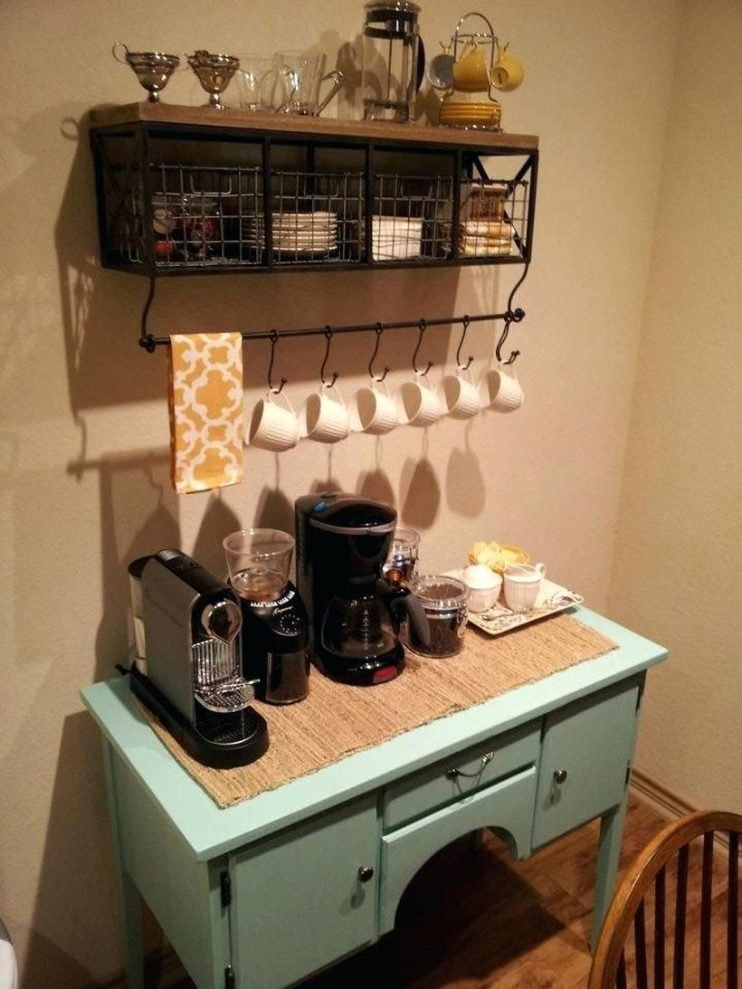 Coffee bar made of light blue wood combined with small drawers, wooden shelves and black iron