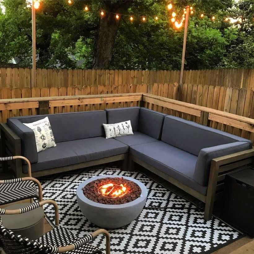 Cool-deck-fire-pit-patio-design-with-chair-rattan-and-black-and-white-rug-for-your-inspiration