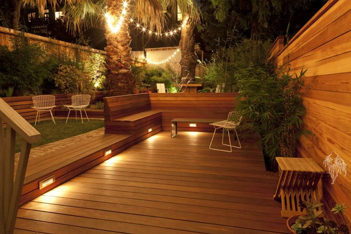 Decorative-lighting-by-connecting-led-lights-from-one-tree-to-another-in-order-to-create-good-lighting-on-your-rooftop