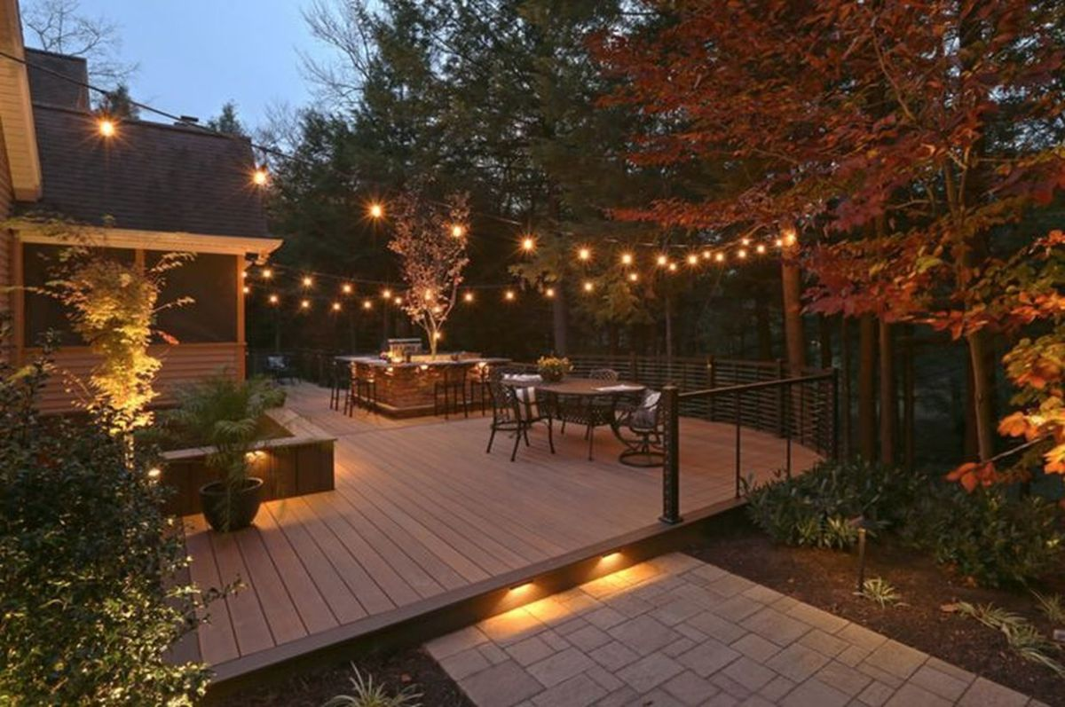 Decorative-lighting-on-your-backyard-patio-deck-by-extending-light-bulbs-to-get-good-lighting-and-feel-serene-at-night