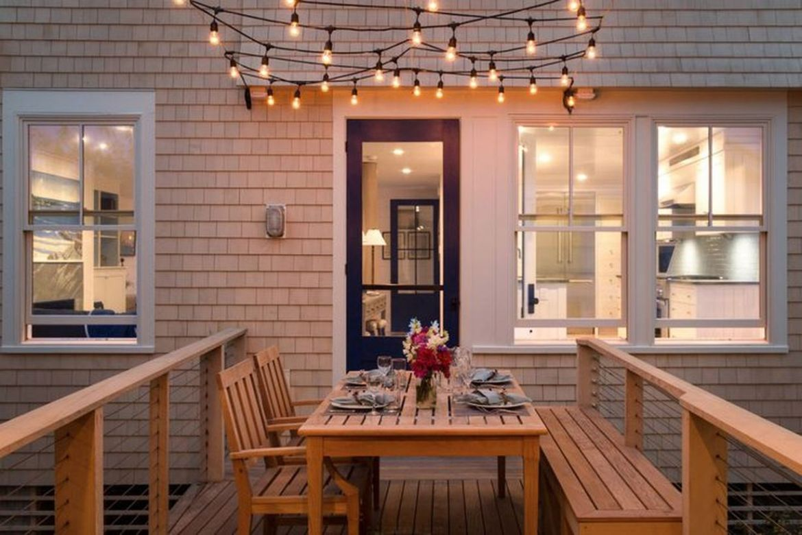 Decorative-lighting-with-light-bulbs-that-are-yellow-and-arranged-in-order-to-get-good-lighting-at-night-on-your-backyard-patio-deck
