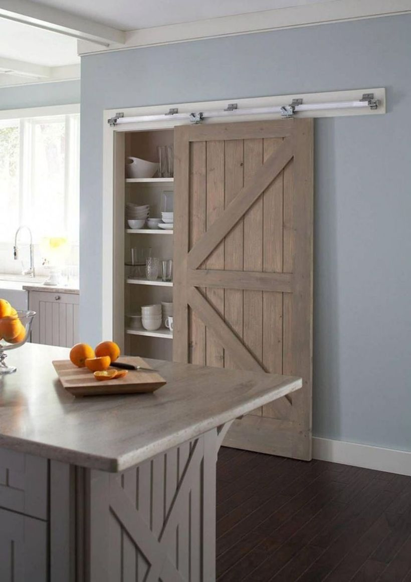 Gray-wooden-kitchen-island-and-wooden-sliding-door-for-tiered-shelves
