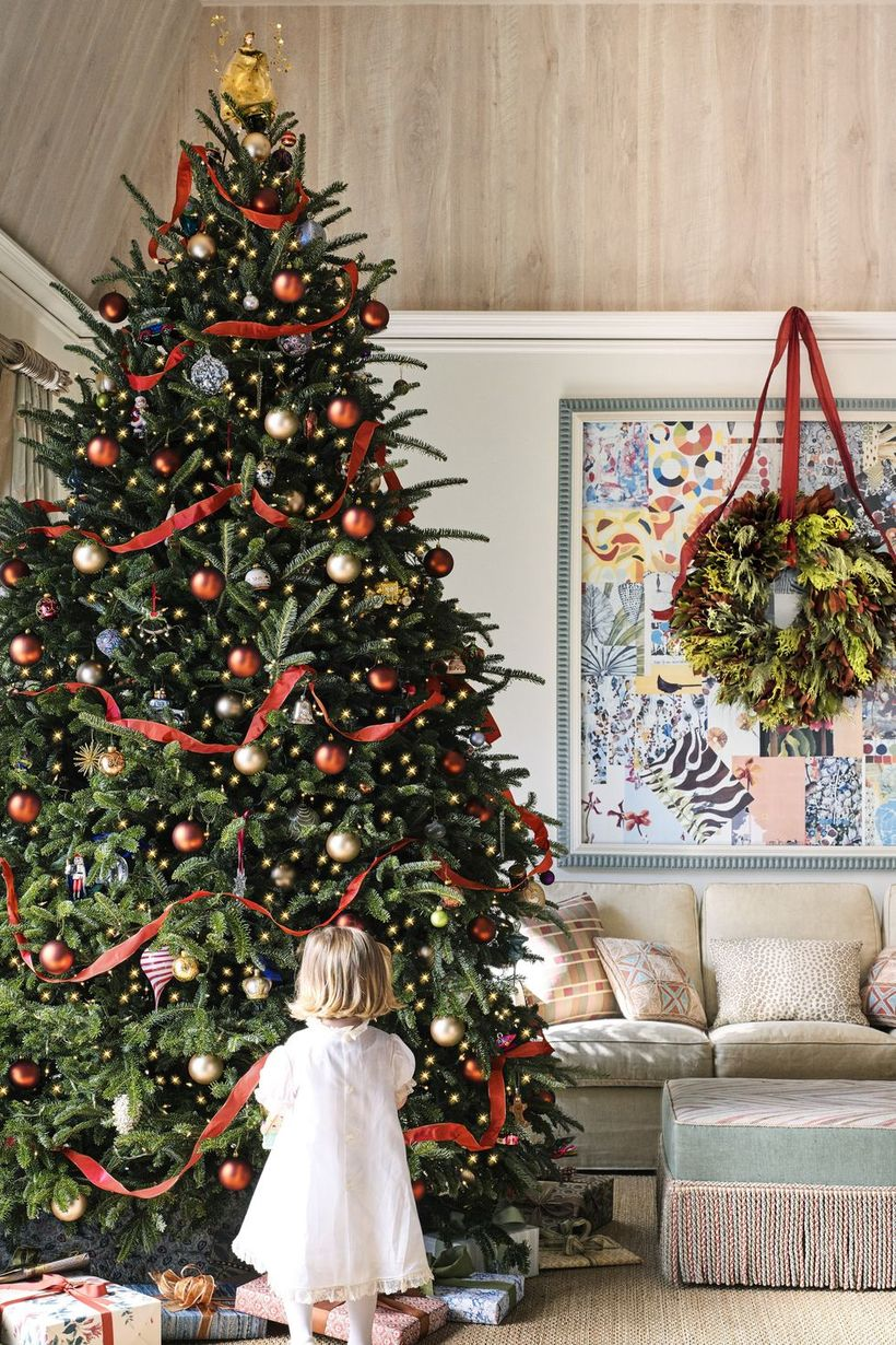 Green-christmas-tree-with-gold-bell-ornament-and-red-crepe-paper-to-decorate-the-tree-to-create-interesting