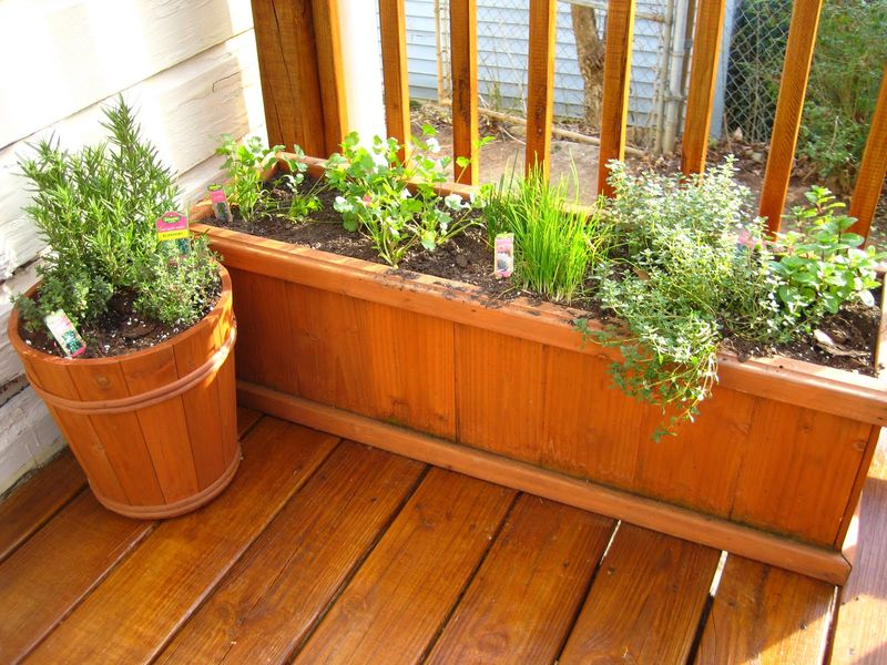 Interesting-balcony-garden-with-herb-and-a-place-use-recycled-wood-to-get-beauty-in-the-corner-of-the-balcony.