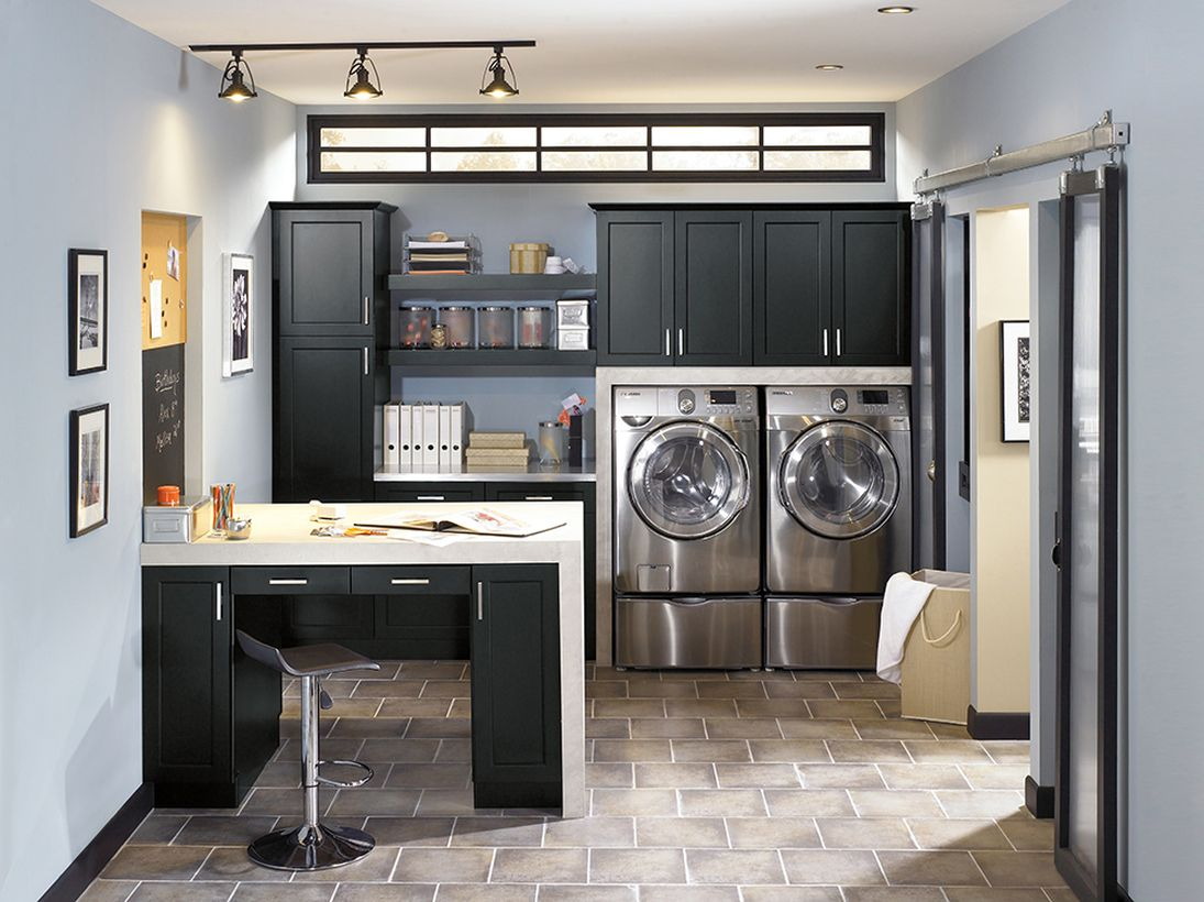 Laundry room with black cabinet and silver washing machine