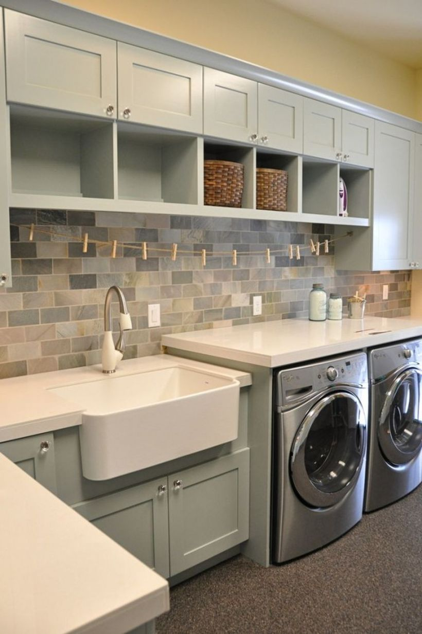 Laundry room with gray cabinet and white sink