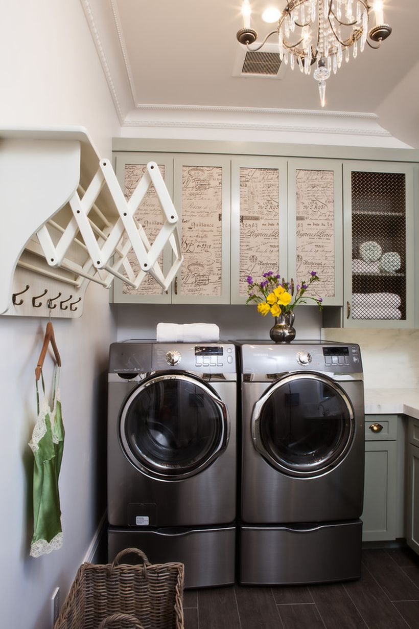 Laundry room with unique cabinet, white walls and wooden hanger