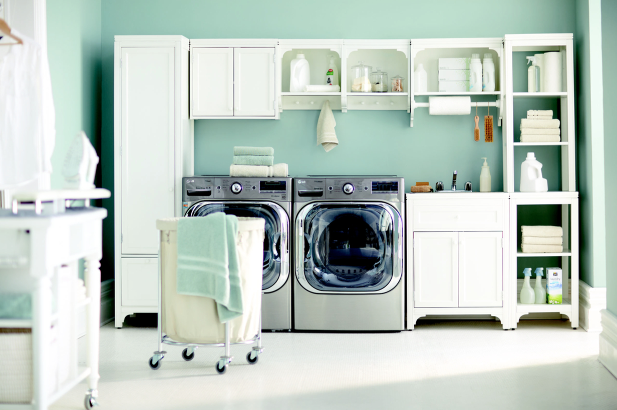 Laundry room with white cabinet and white rack decoration