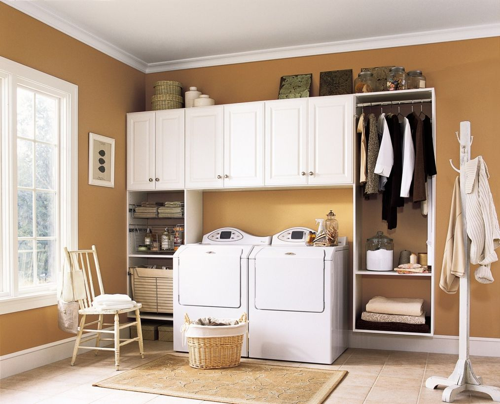 Laundry room with white cabinet, white washing machine and gray walls