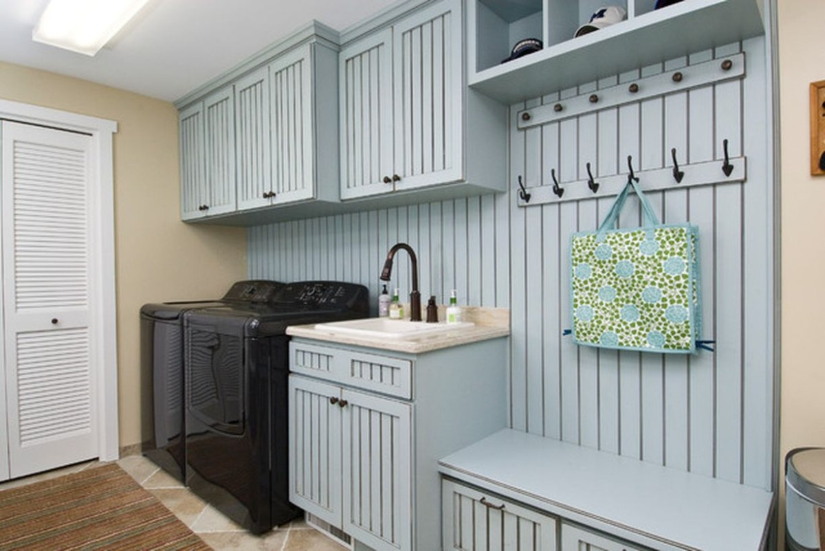 Laundry room with wooden cabinet and black washing machine