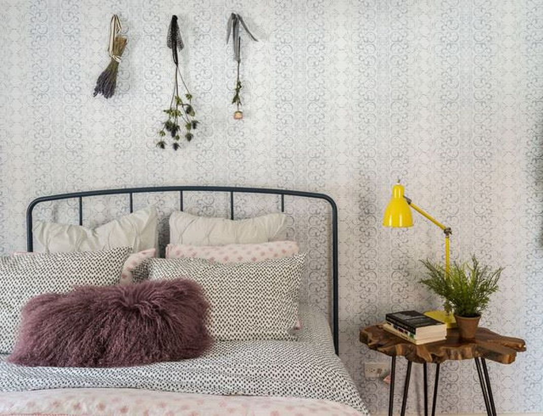 Minimalist-bedroom-with-an-iron-frame-to-show-the-boho-style-atmosphere-can-add-a-unique-night-stand-yellow-table-lamp-and-dream-catcher-for-decoration-wall