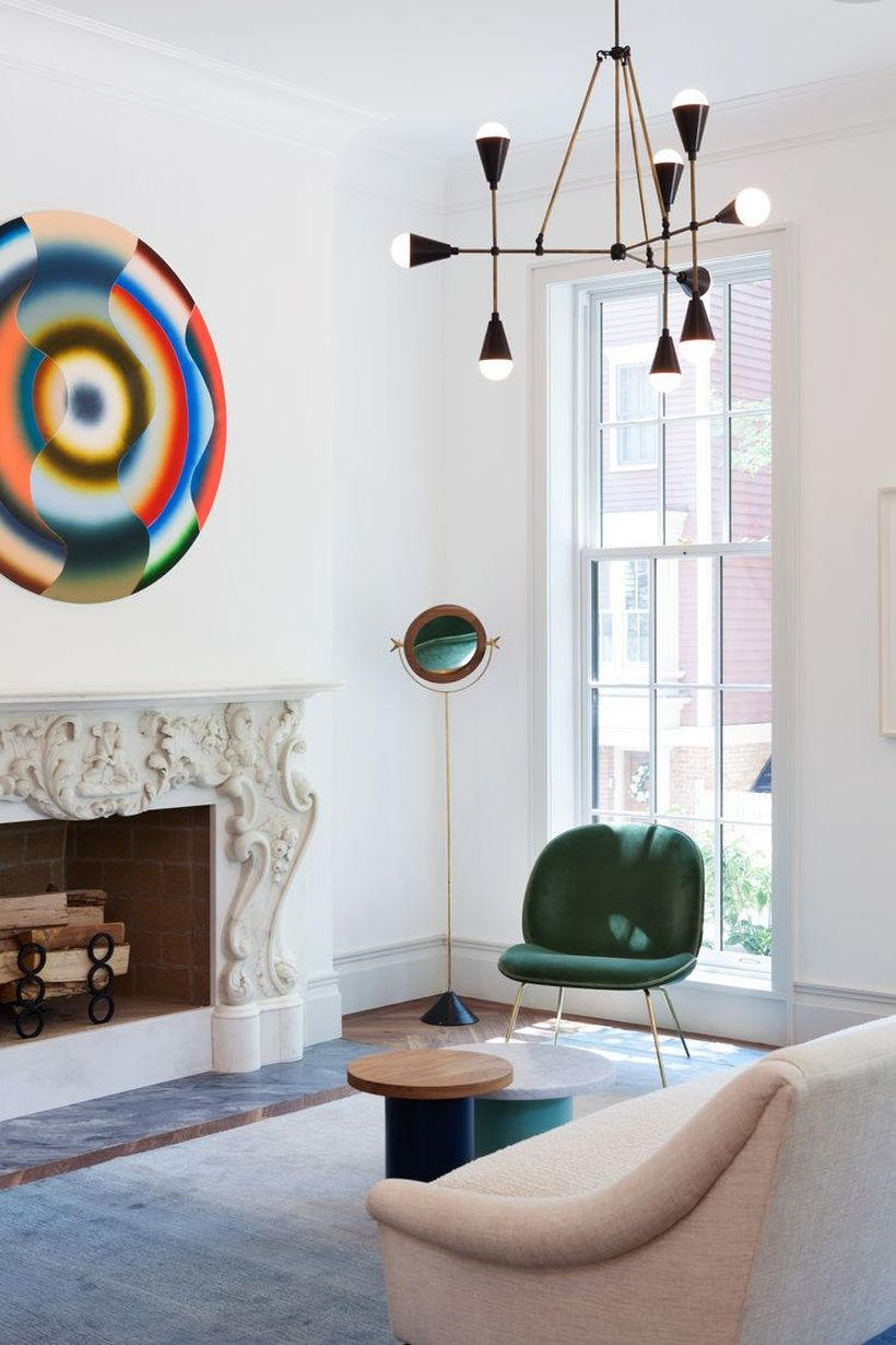 Minimalist-round-coffee-table-and-brown-chair