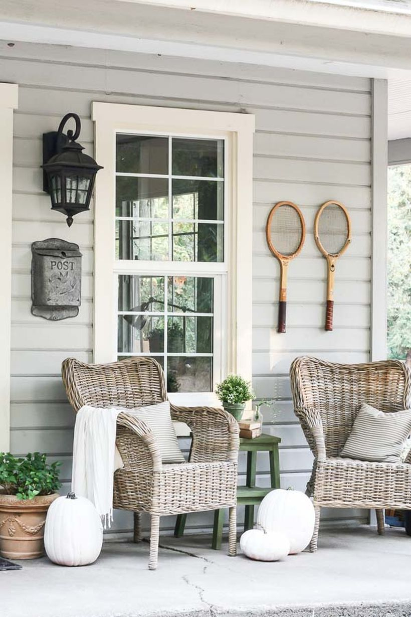 Proch with rattan chairs and white pumpkin