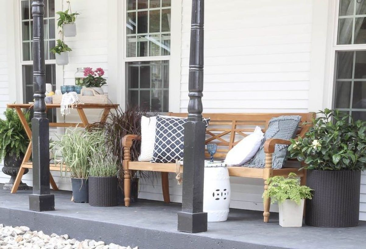Proch with wooden chairs and plants