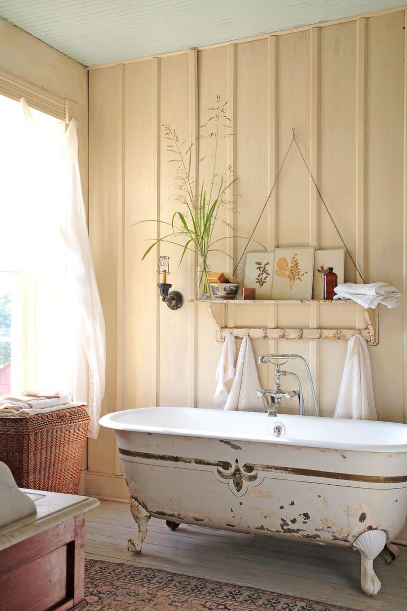 Rustic-bathroom-design-with-hanging-rack-on-the-wall-and-classic-bath-tube-you-must-have