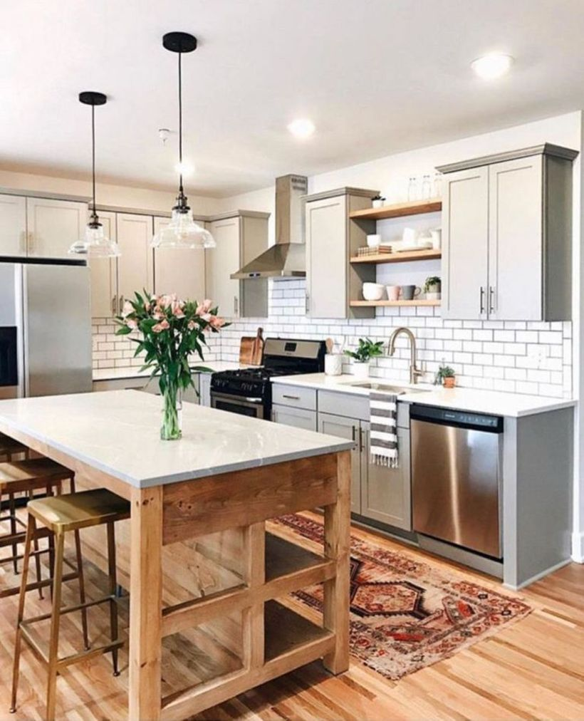 Rustic-kitchen-design-with-gray-kitchen-cabinet-wooden-kitchen-table-and-chair-wooden-vinyl-floor-added-bohemian-motif-rugs