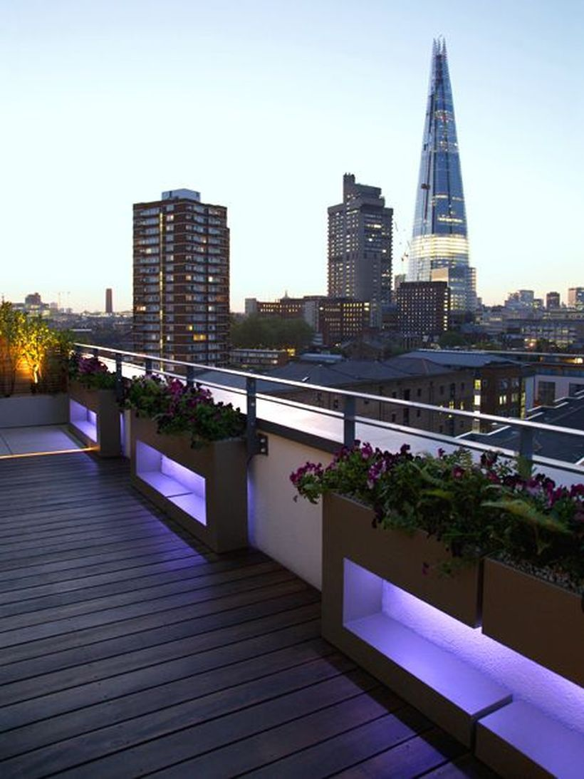 Shard-rooftop-with-decorative-lighting-under-the-garden-bed-to-create-good-lighting