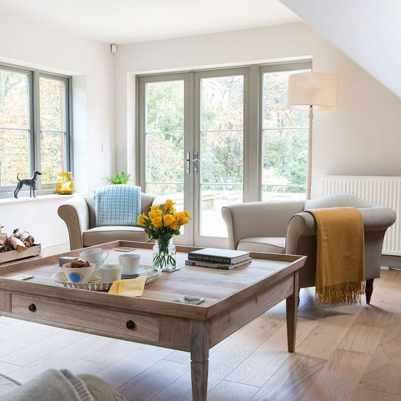 Soft-white-sofa-and-square-wooden-coffee-table-combined-with-wooden-flooring-to-inspire-your-neutral-color-scheme-living-room