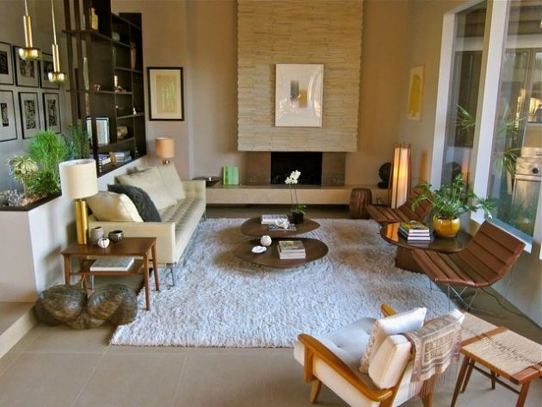 Unique-round-coffee-table-and-wooden-chair-with-an-iron-frame-suitable-for-relaxing-and-added-velvet-rug-to-make-it-more-comfortable