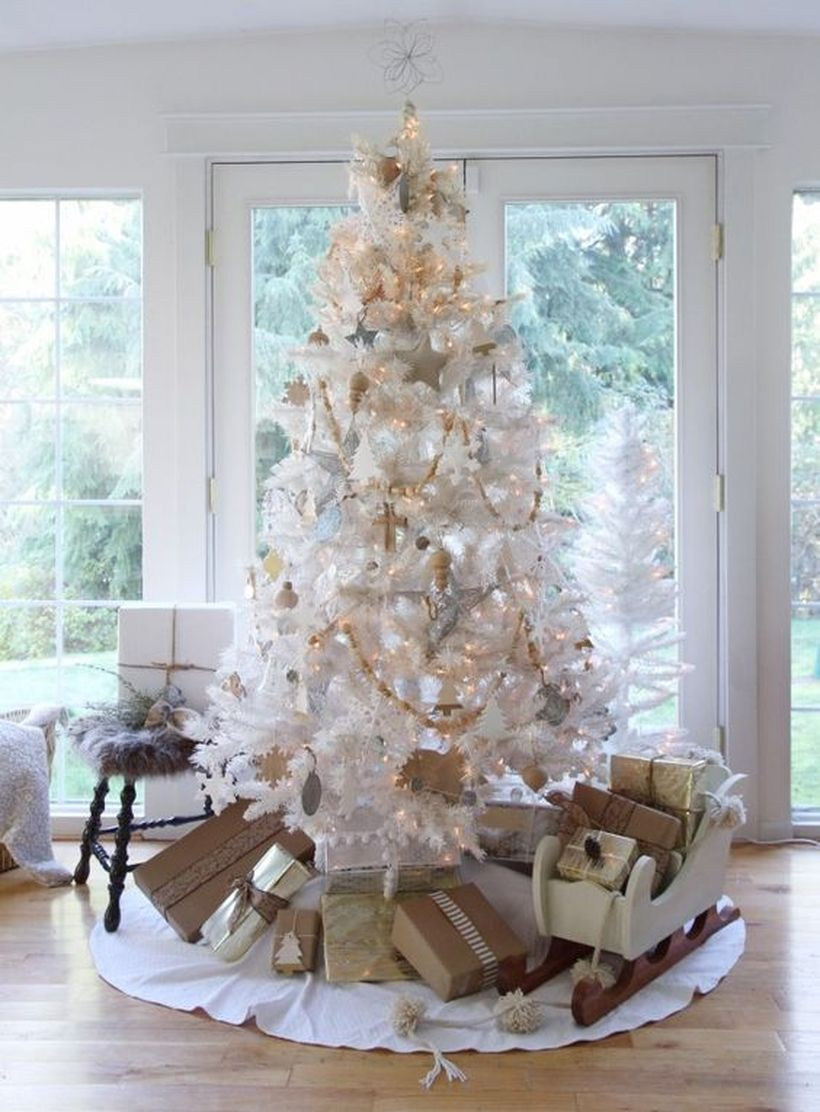 Vintage-white-christmas-tree-with-decorative-lighting-and-star-ornaments-of-small-and-large-sizes