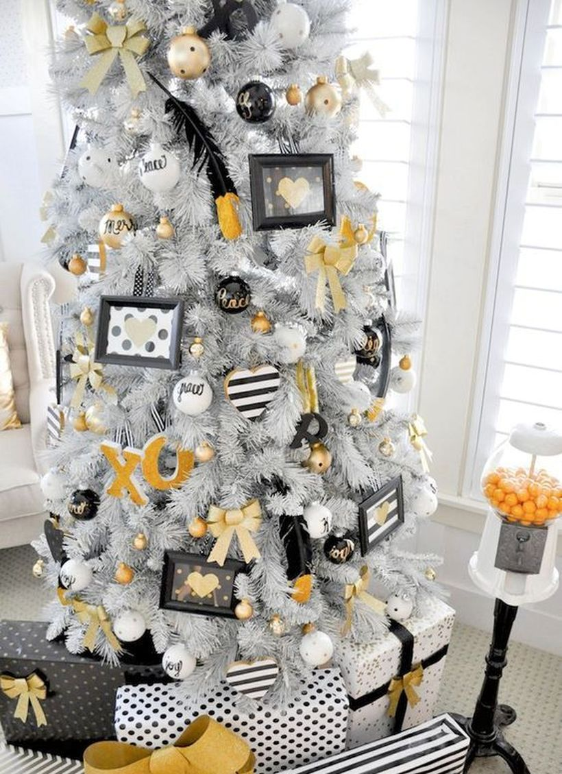 White-christmas-tree-with-various-ornaments-hung-on-the-tree-and-whimsy-white-black-and-gold-decor