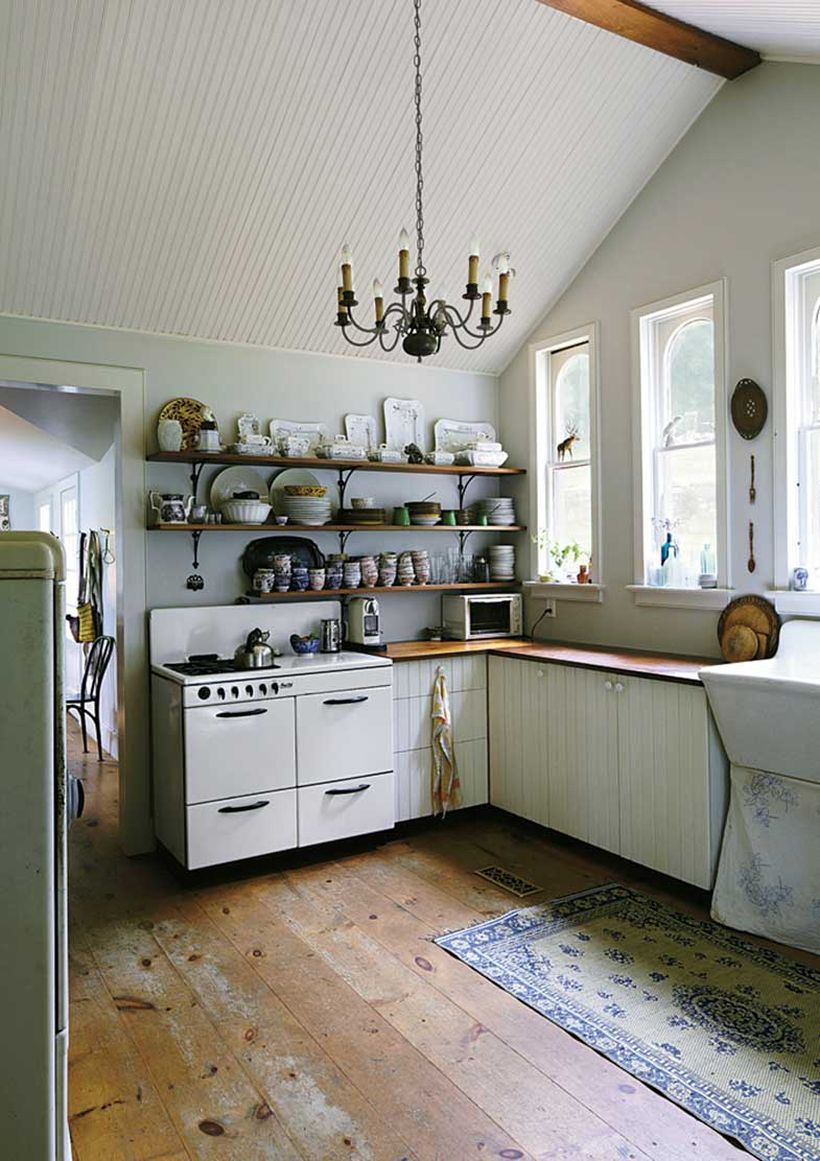 White-wooden-pallet-kitchen-cabinet-and-long-tiered-hanging-rack-to-store-a-variety-of-small-ornaments-for-your-kitchen-you-can-apply