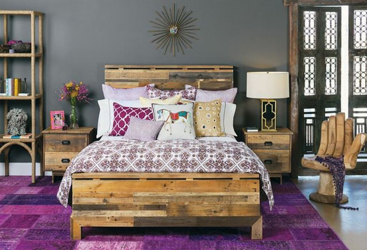 Wooden-pallet-bedroom-with-add-unique-bed-linen-patterns-for-a-boho-style-touch-and-to-make-it-attractive-and-beautiful-to-your-bedroom
