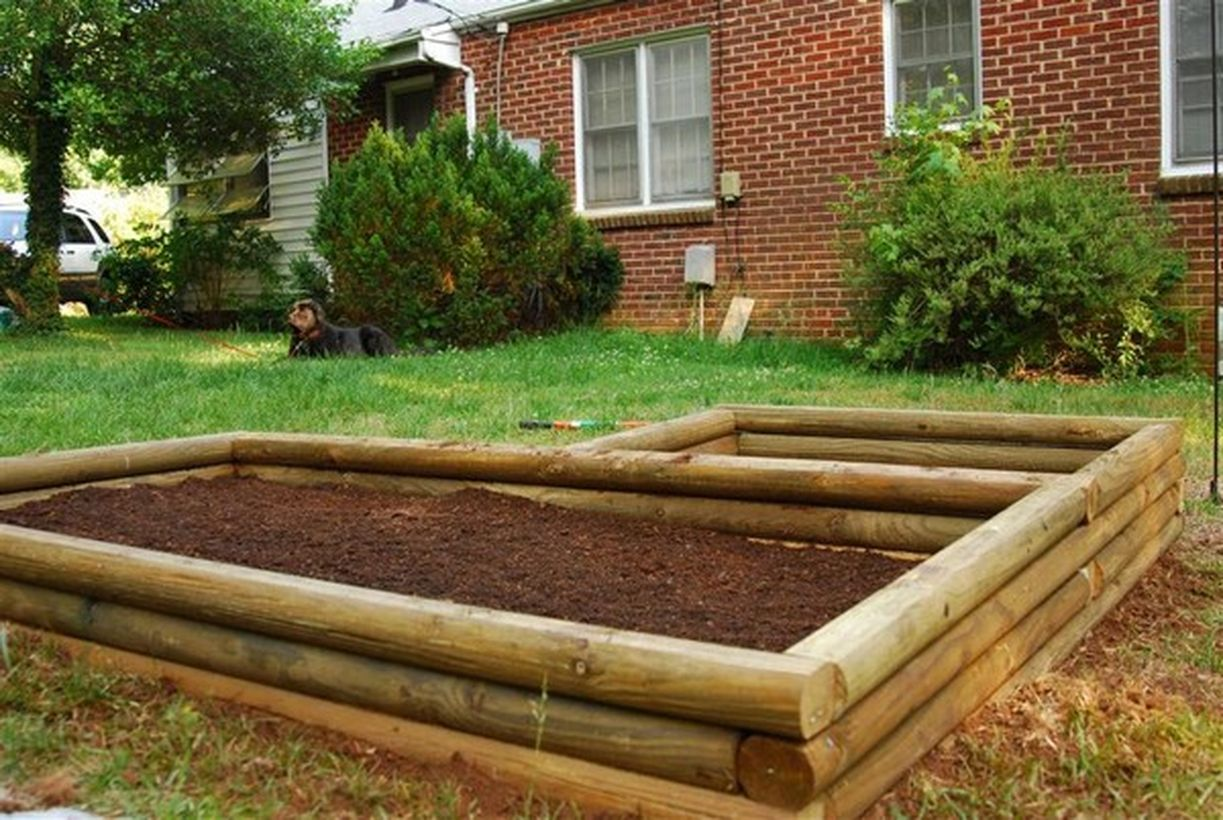 1raised-beds-constructed-from-landscape-timbers-are-perfect-for-separating-the-plants-on-the-backyard.