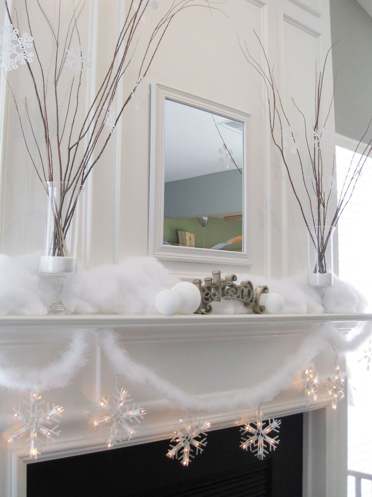 Big fireplace combined with branch decoration above it