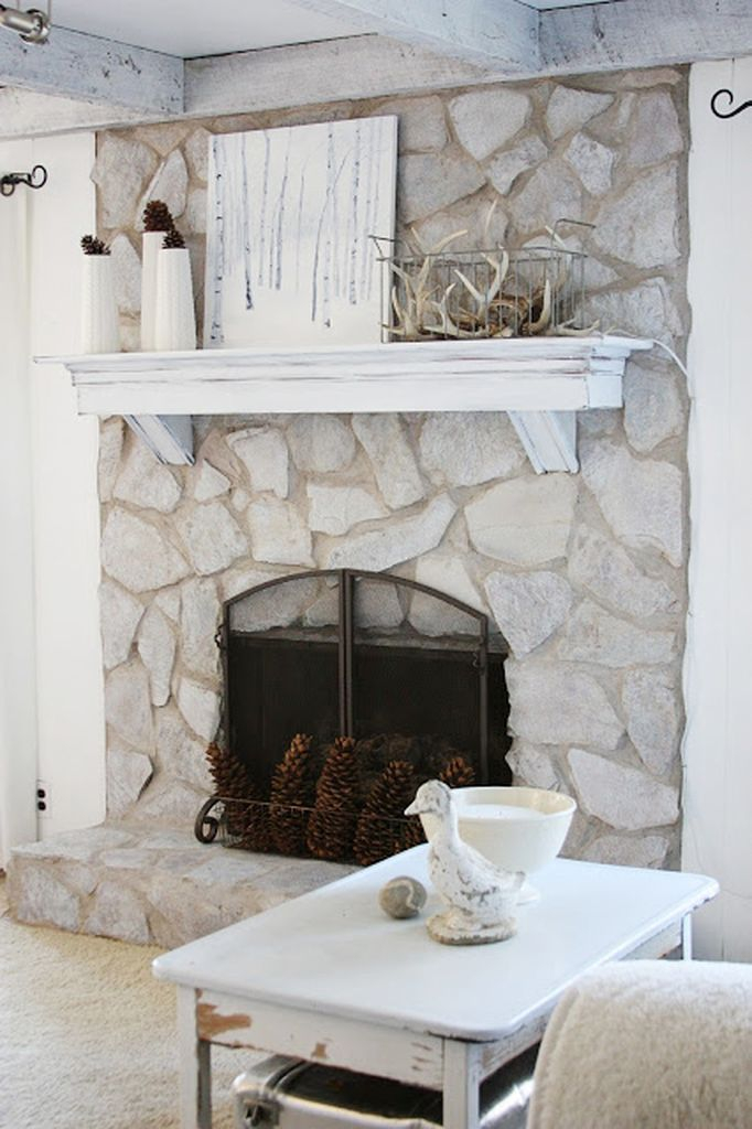 Big stone fireplace combined with floating wooden shelves