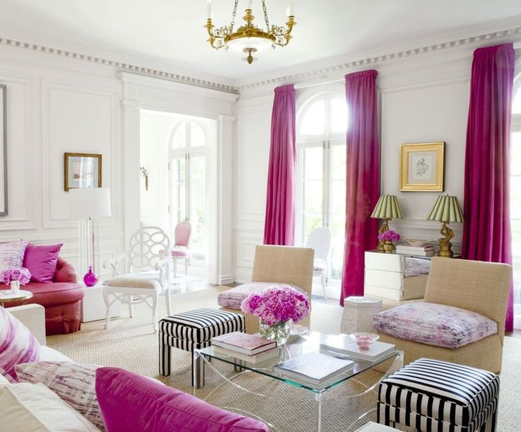 Bright living room with pink curtains and pillows