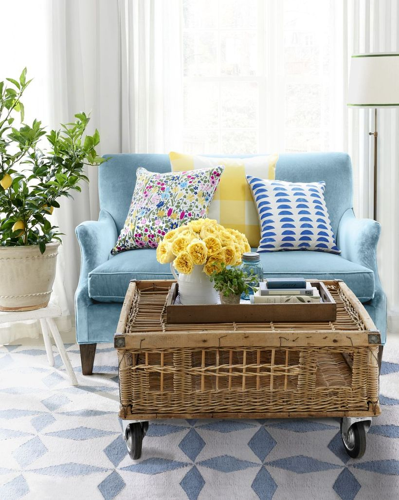Colorful pattern cushion with blue sofa and rattan table