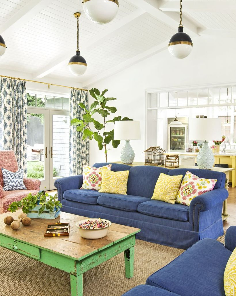 Colorful pattern cushion with blue sofa and wooden table