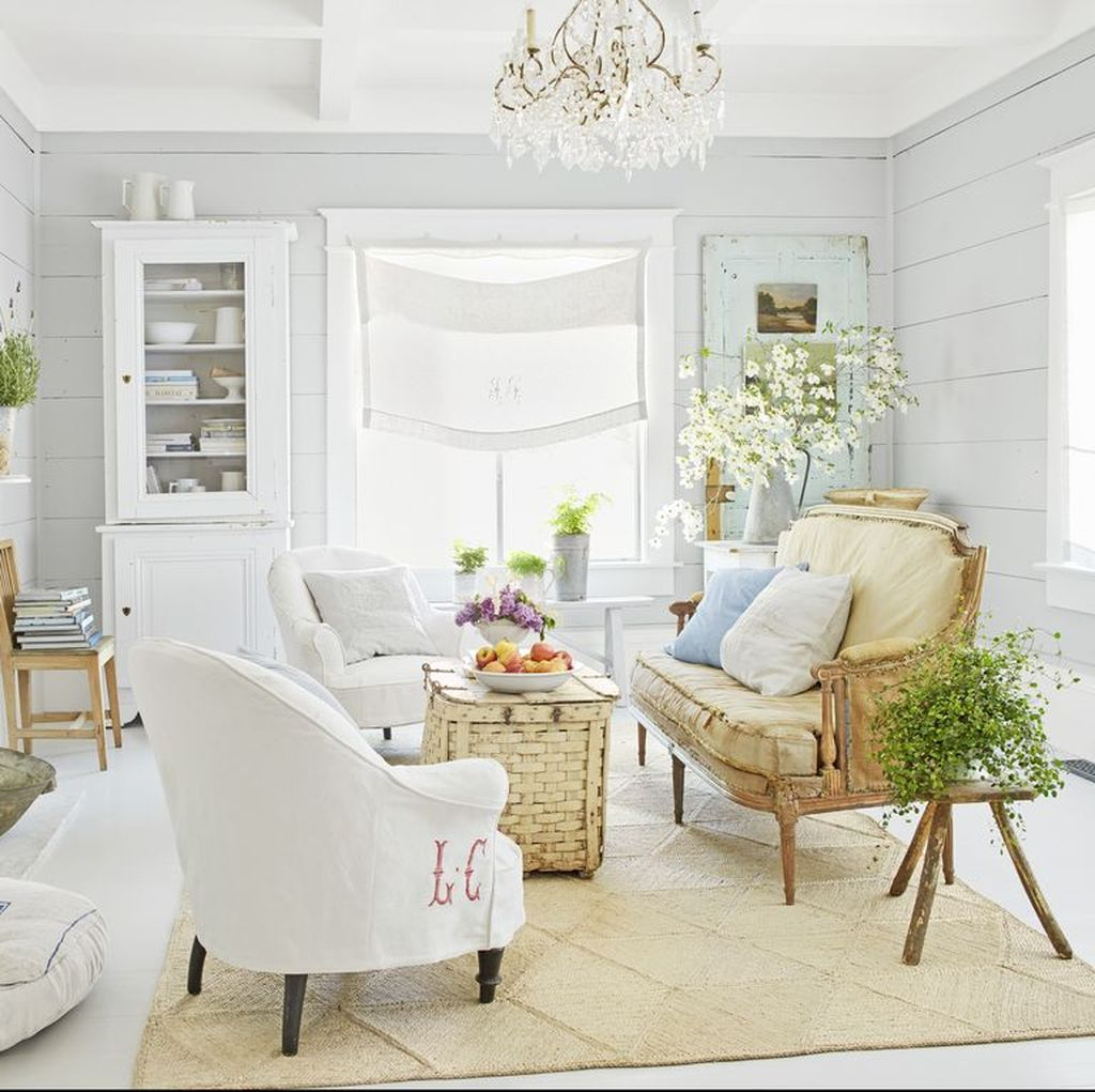 Comfy framhouse living room with woven coffee table and brown sofa combined with white chairs to perfect your living room